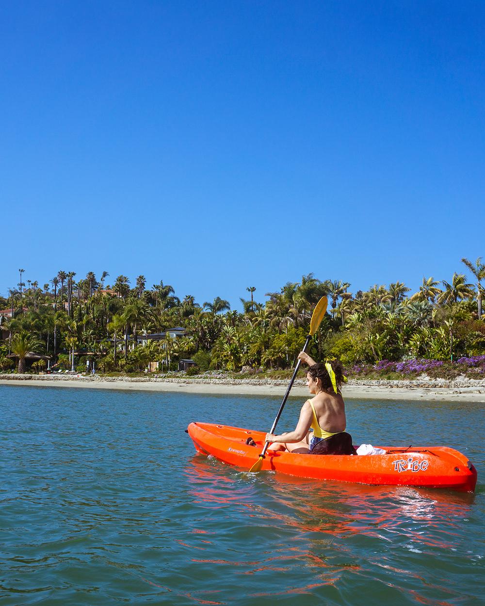 woman kayaking at carlsbad agua hedionda lagoon