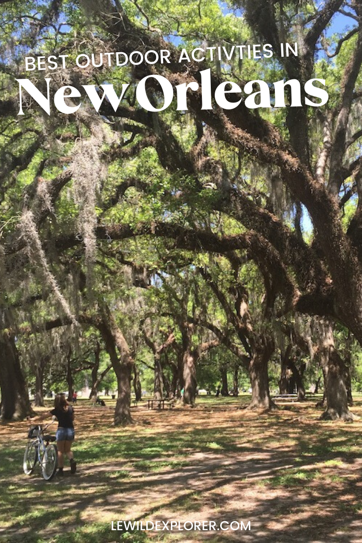 woman with bike at city park in new orleans louisiana