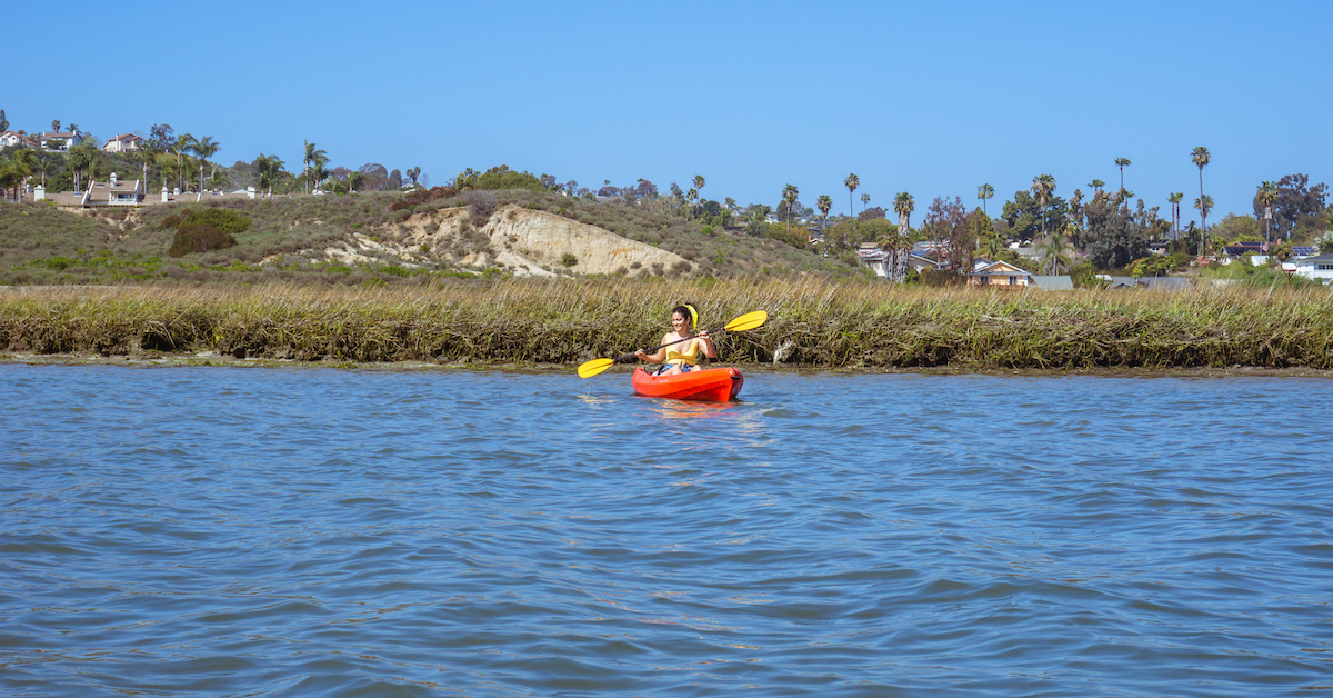 woman on a kayak rental at carlsbad lagoon california