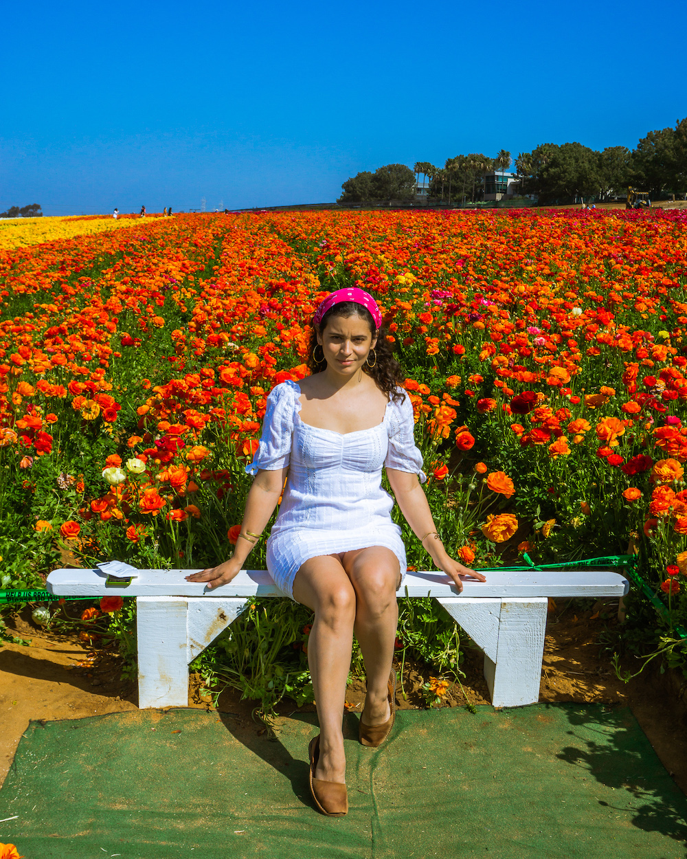 woman in white dress at the flower fields carlsbad