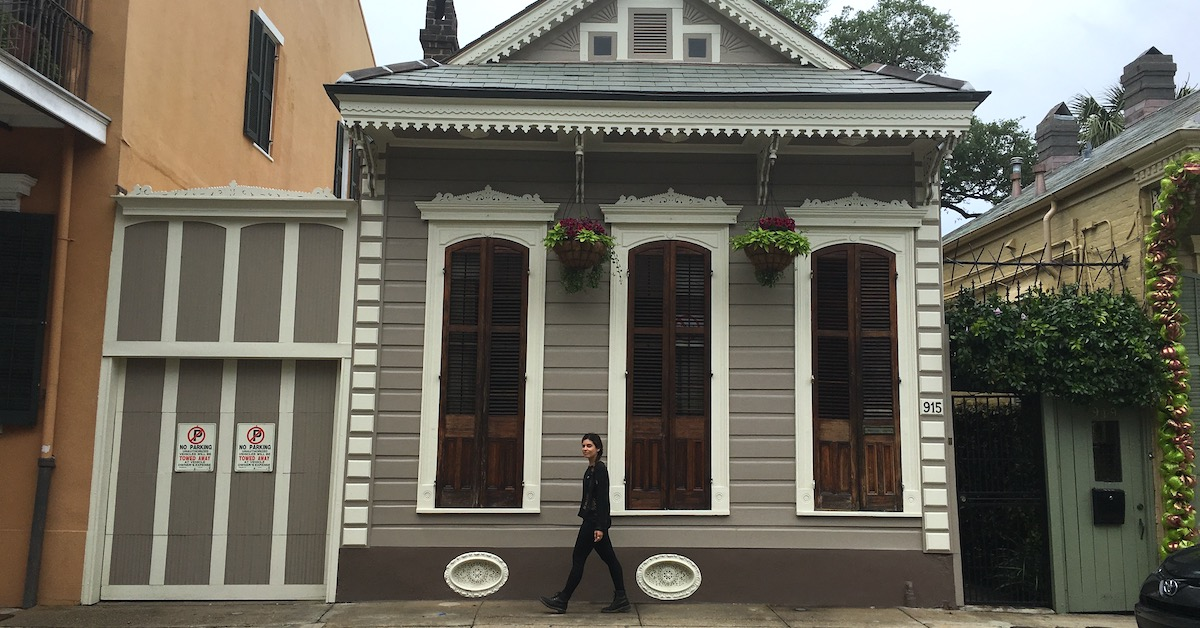 woman walking in front of home in new orleans louisiana