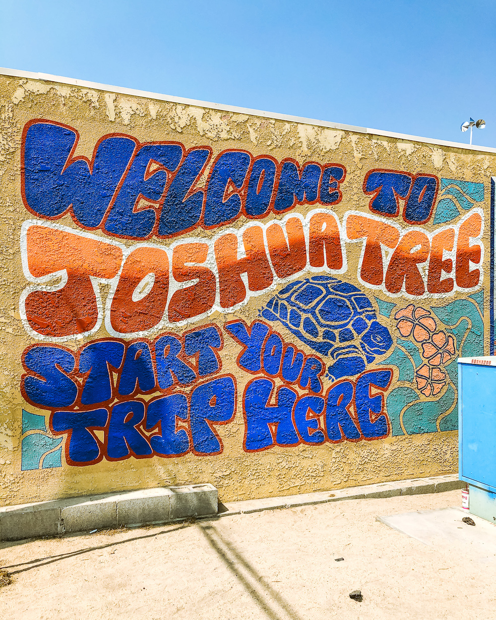 colorful welcome to joshua tree mural