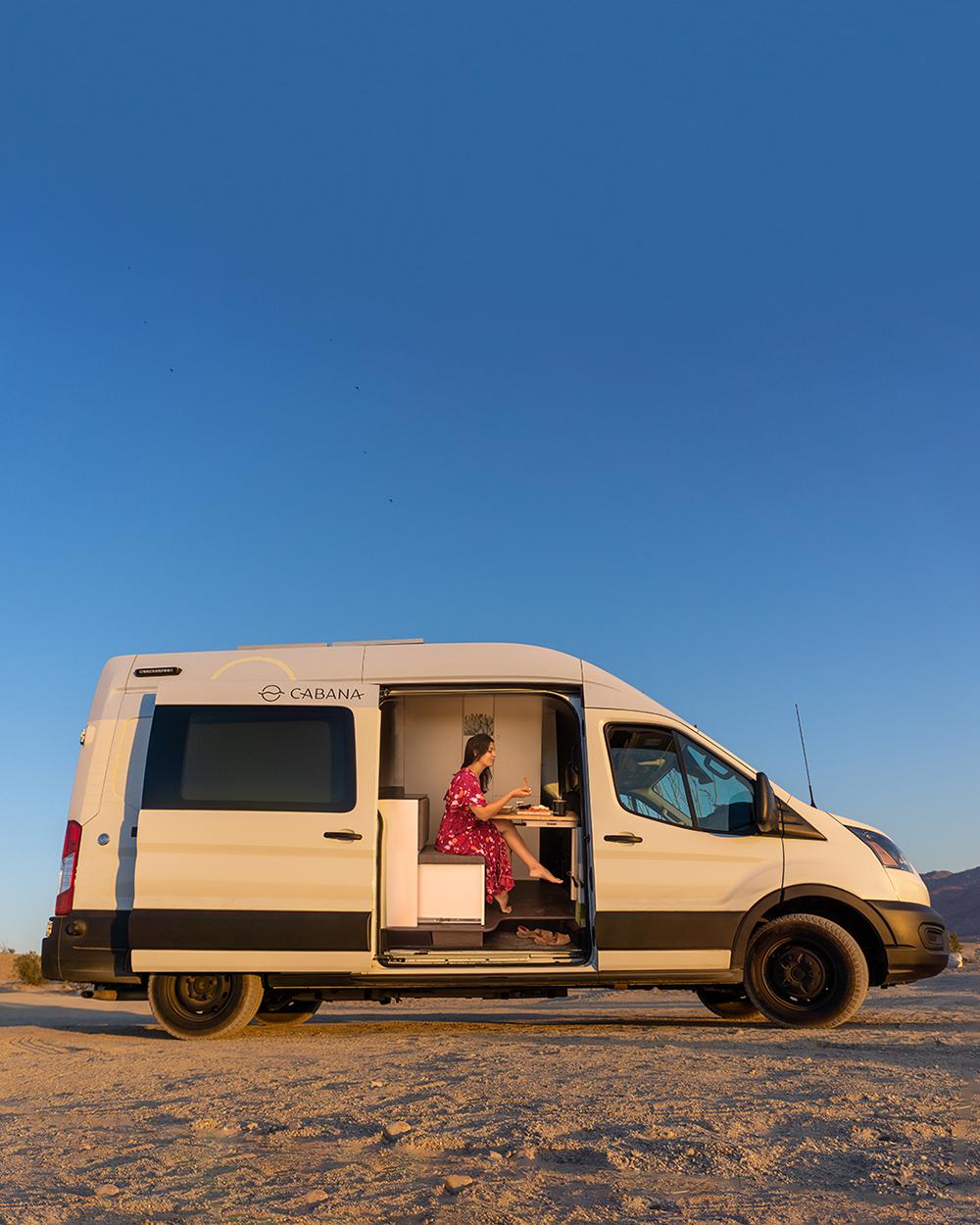 woman eating inside ford campervan
