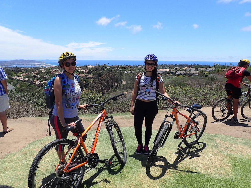 women with bicycles in san diego