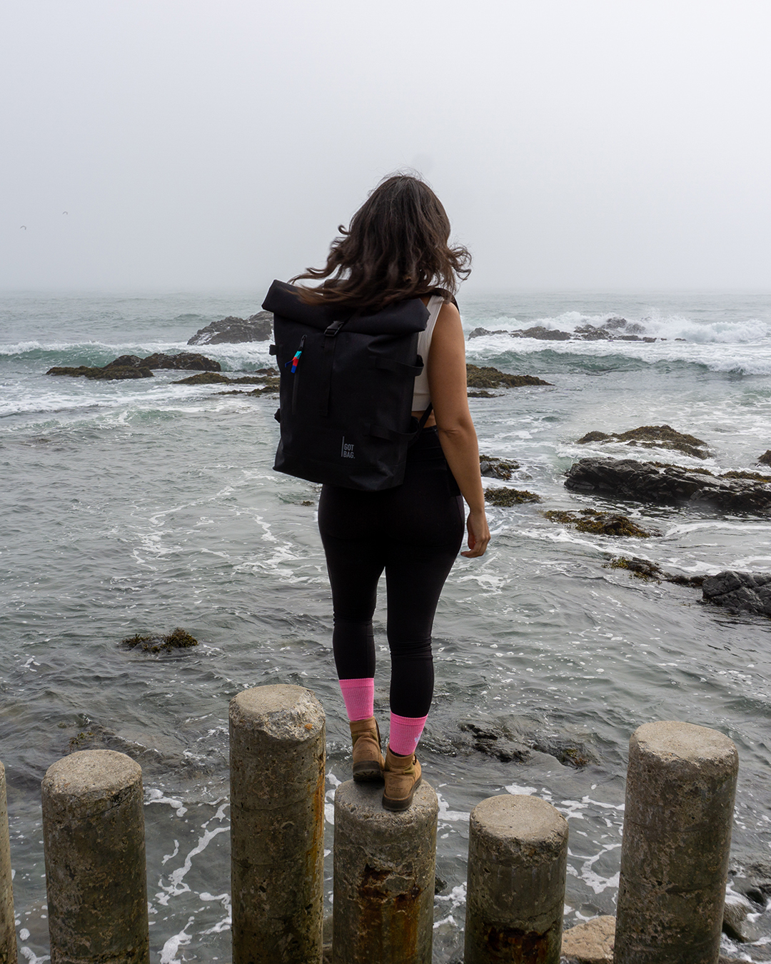 sustainable travel backpack with laptop sleeve