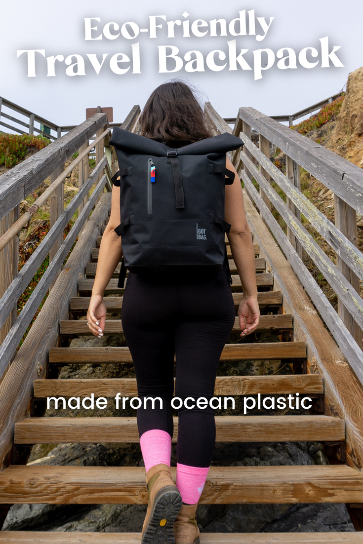 woman walking up wooden stairs wearing black leggings and a backpack