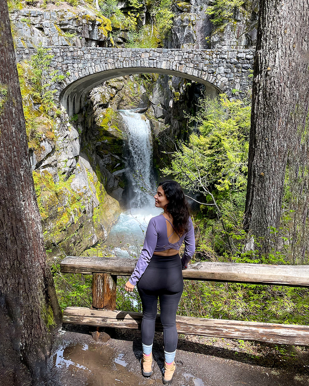 woman at christine falls in mount rainier national park