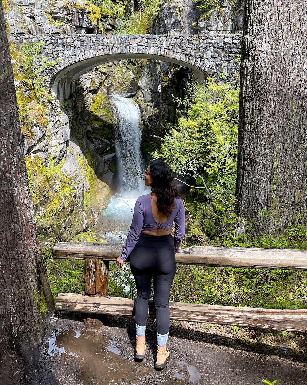 woman at christine falls in mount rainier national park in washington